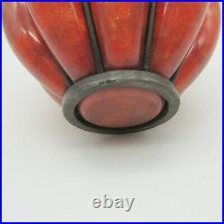 André Delatte. Vase en verre marbré à décor d'inclusions monture en fer forgé XX